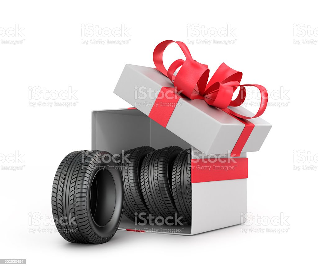 White Gift Box with car tires. stock photo