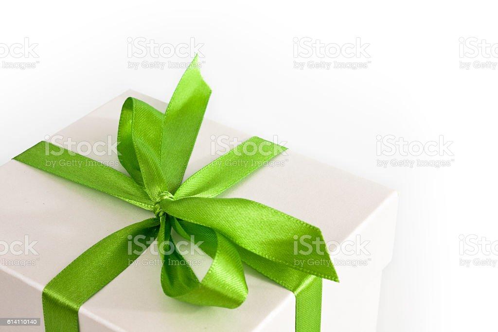 White gift box with green ribbon stock photo