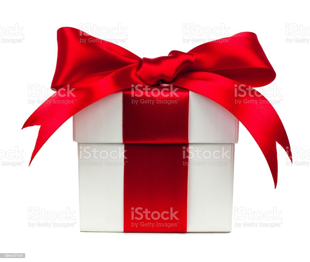 White gift box with red bow and ribbon over white stock photo