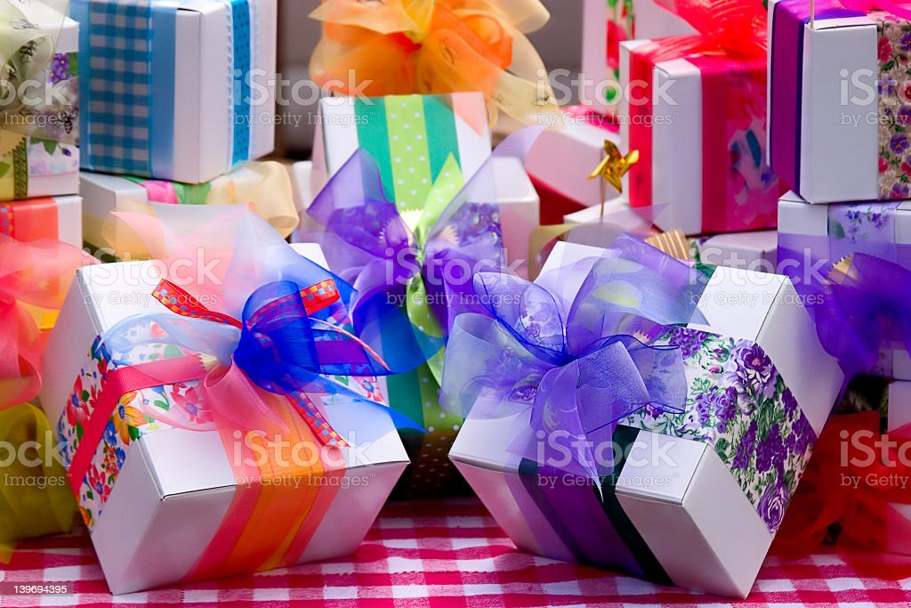 White gift boxes expertly wrapped with ribbons stock photo