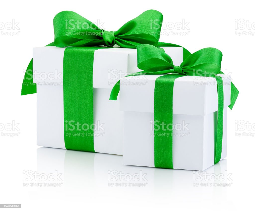 White gift boxes tied green ribbon Isolated on white background stock photo
