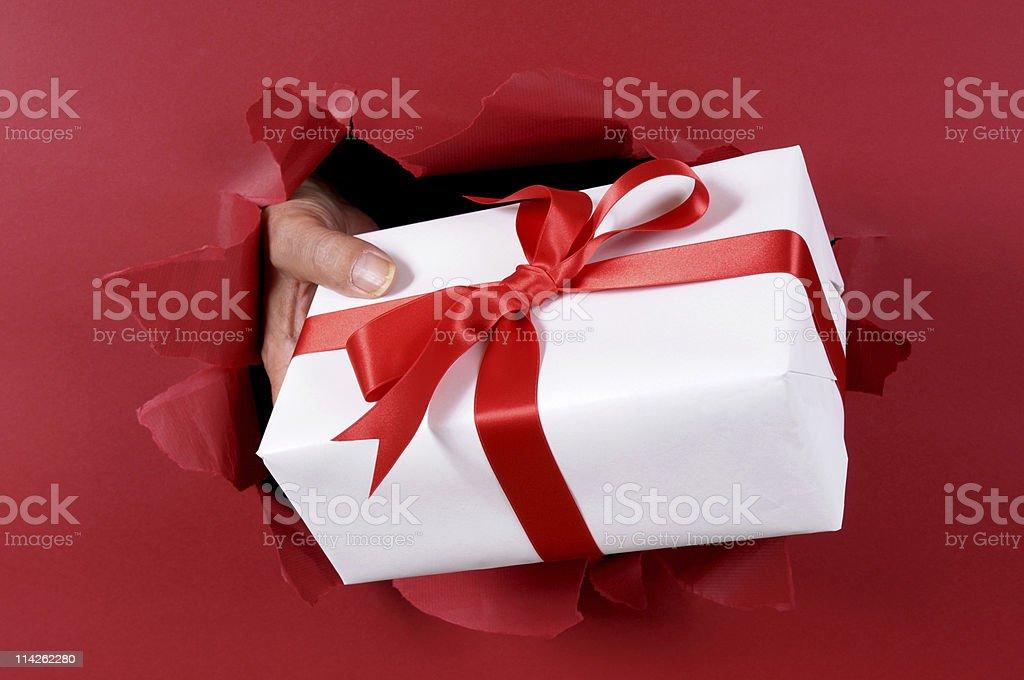 White gift bursting through red background royalty-free stock photo