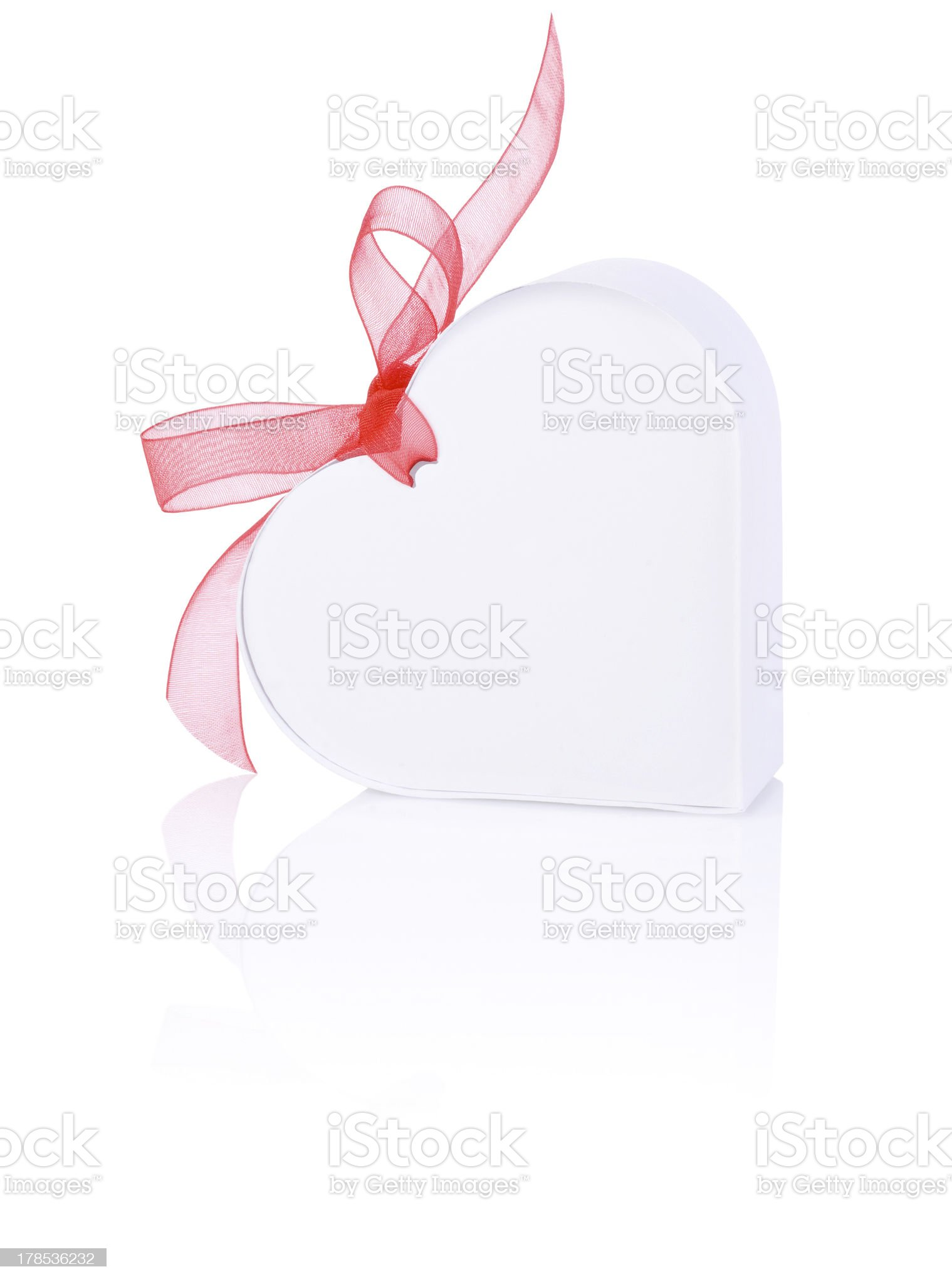 White gift form of heart with bow red ribbon royalty-free stock photo