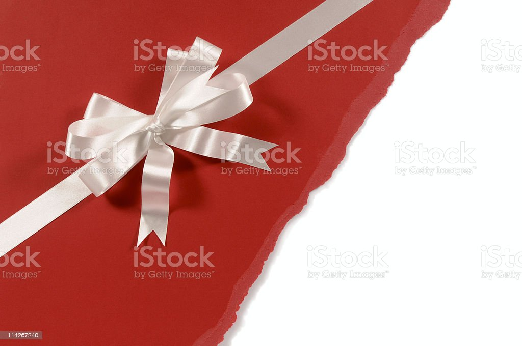 White gift ribbon and bow on red paper stock photo