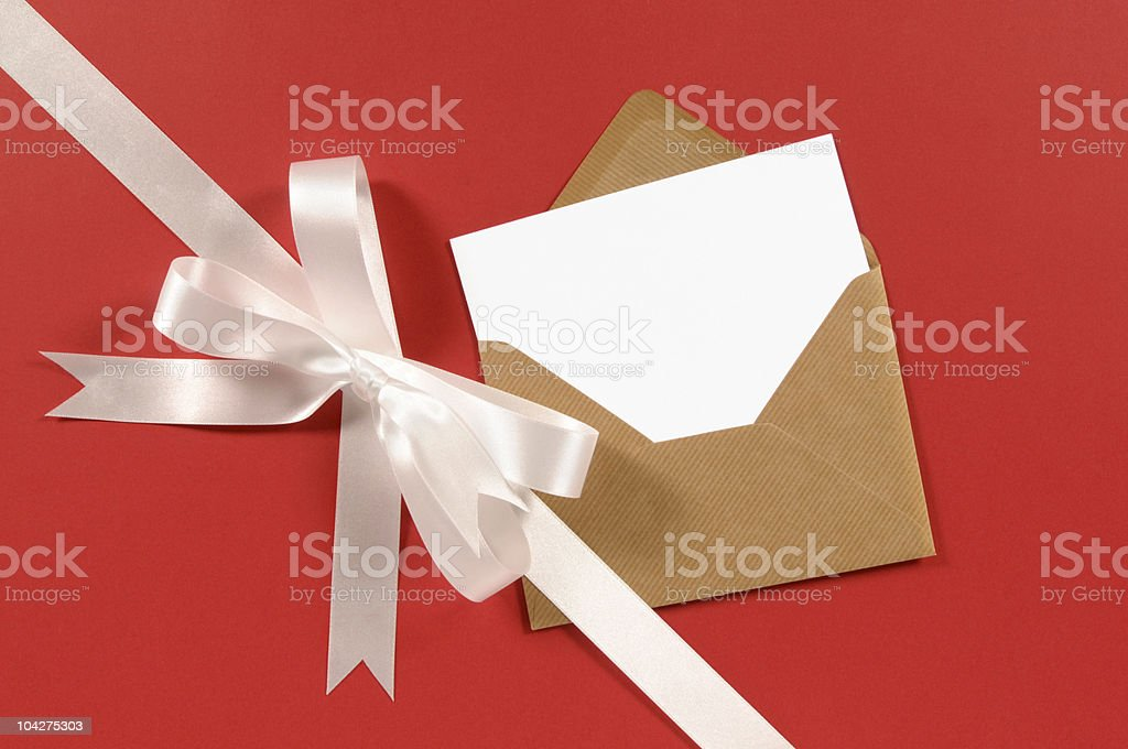 White gift ribbon on red paper with blank card royalty-free stock photo