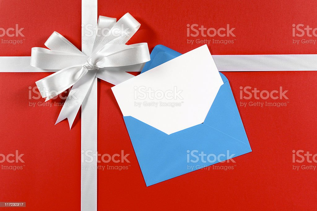 White gift ribbon on red paper with blue envelope royalty-free stock photo