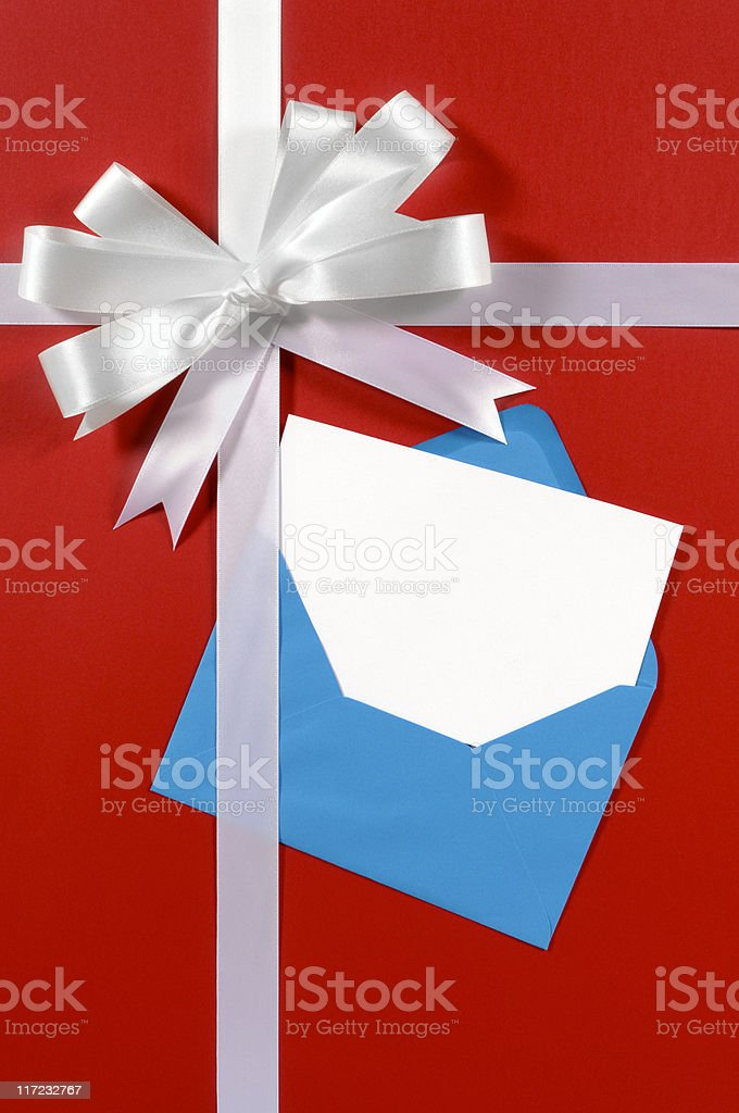 White gift ribbon on red paper with blue envelope stock photo