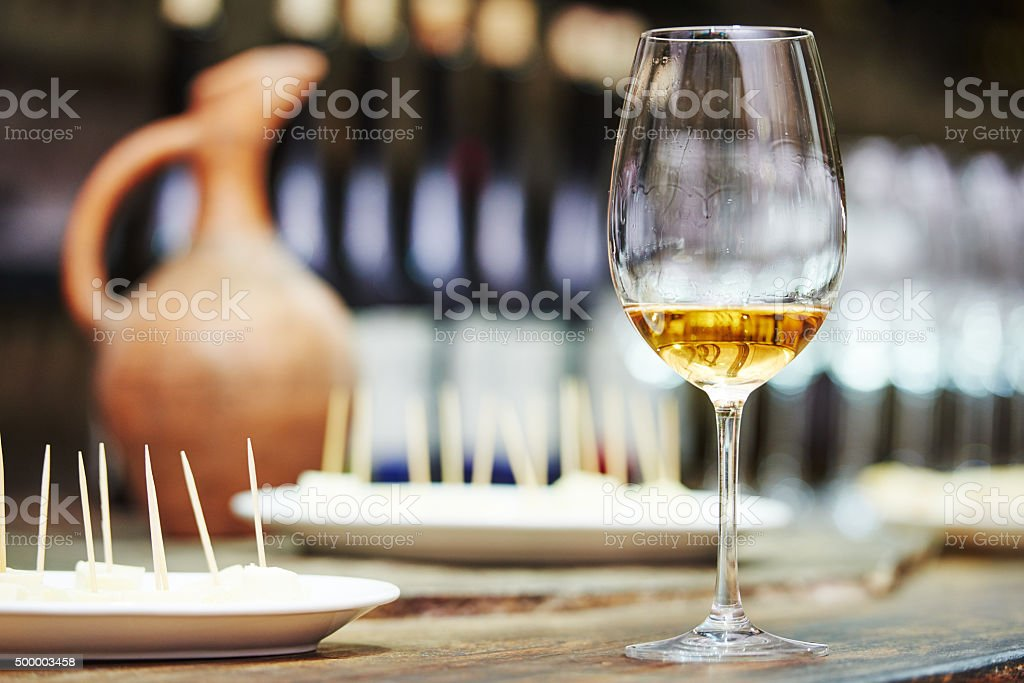 white glass of wine for tasting stock photo