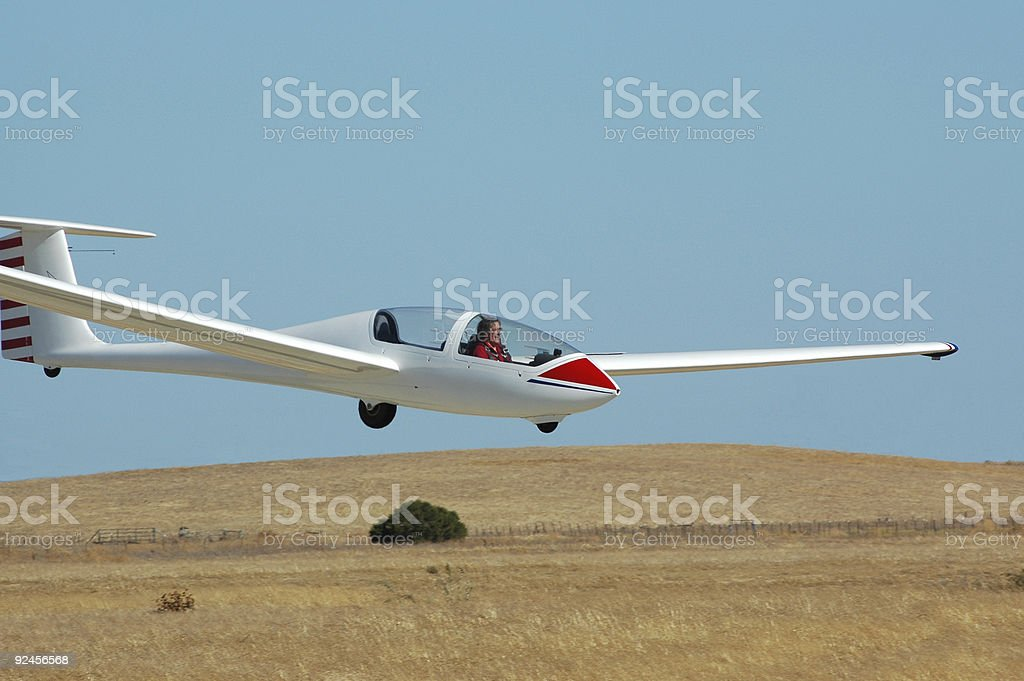 white glider, Grob 103, landing on a clear day stock photo