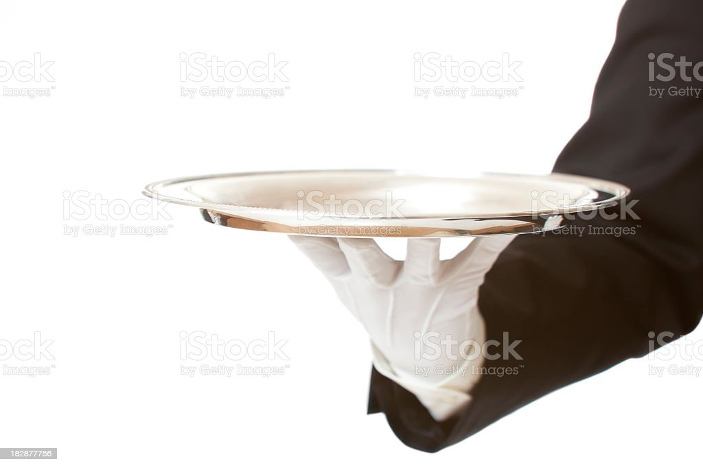 White gloved butler presenting an empty silver tray stock photo