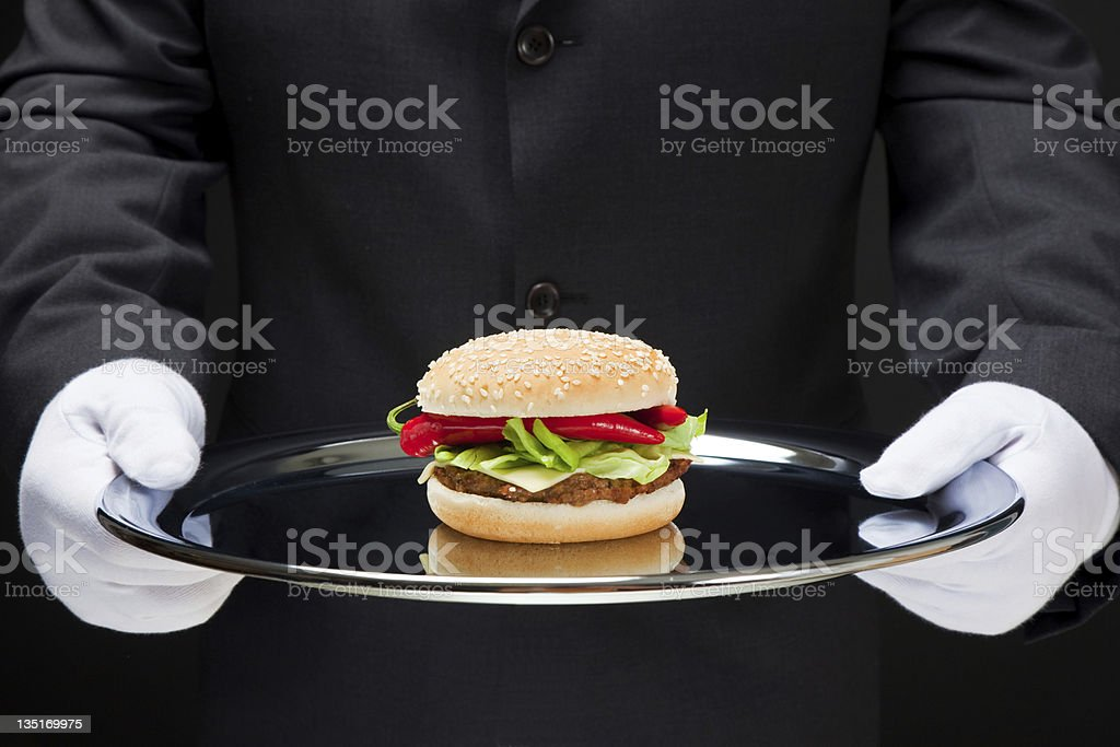 White gloved butler serving hamburger royalty-free stock photo