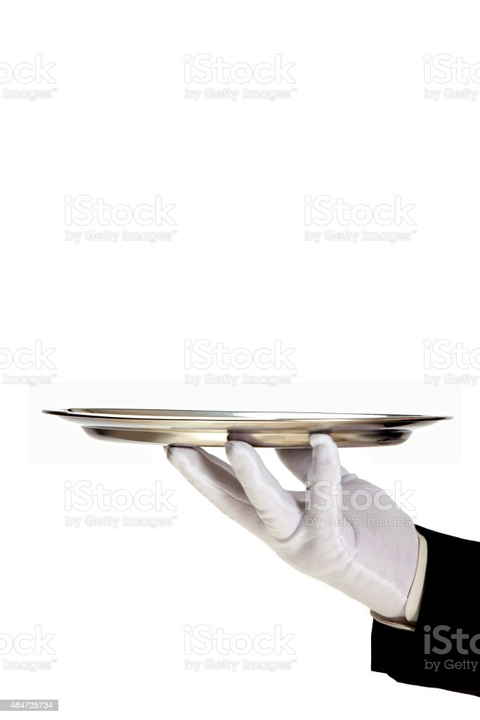 White gloved hand holding an empty silver tray stock photo