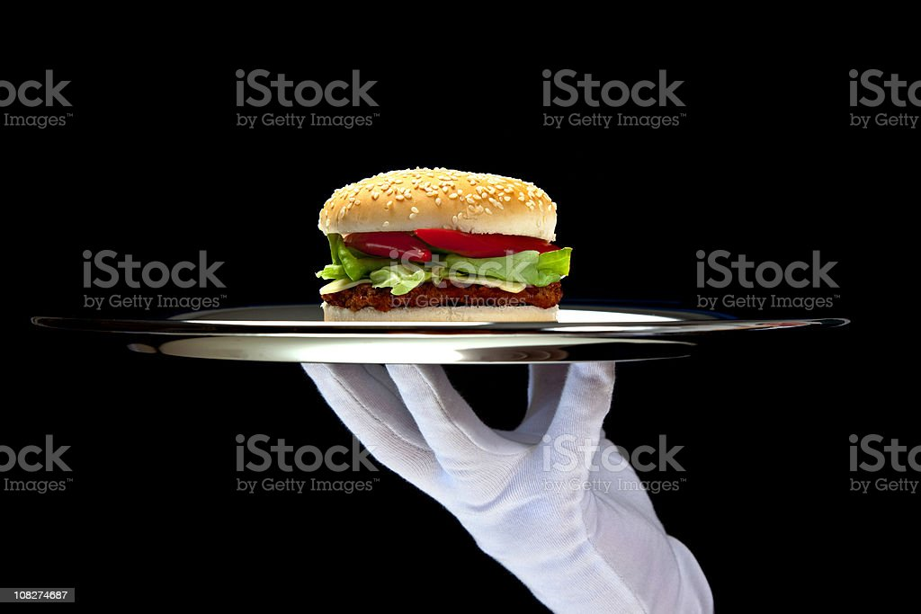 White Gloved Hand Holding Platter with Hamburger royalty-free stock photo
