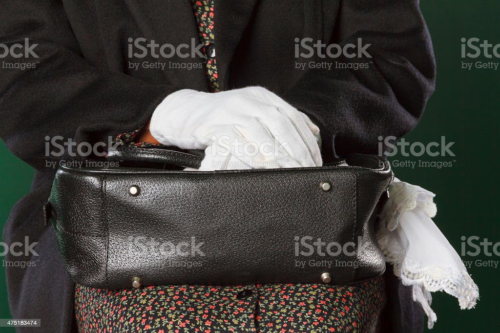 White Gloved Hands Holding Black Purse, Civil Rights stock photo