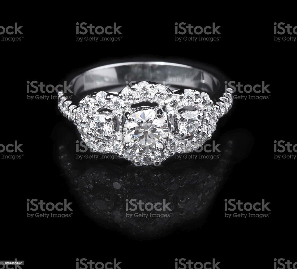 White gold diamond ring on black background royalty-free stock photo