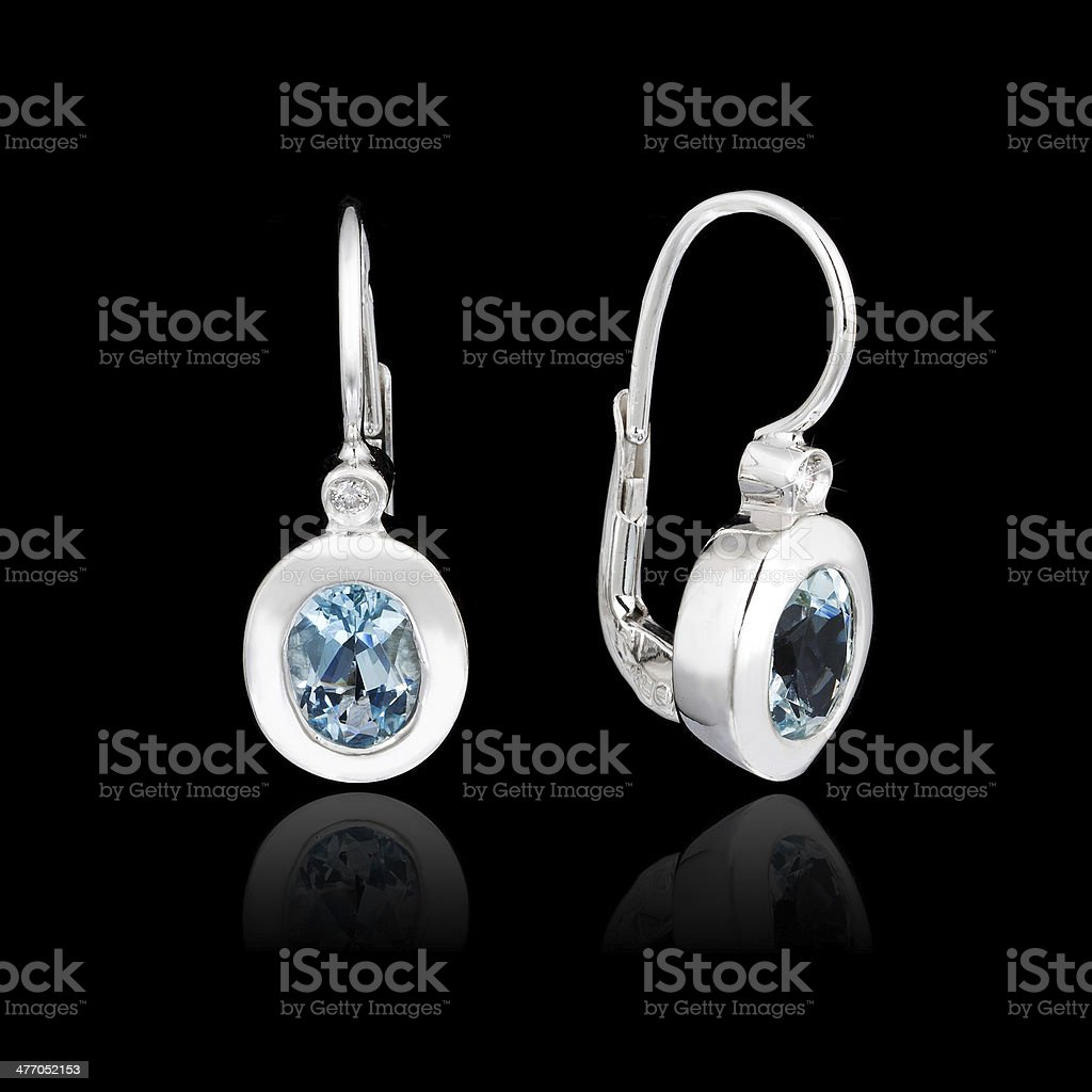White gold earrings stock photo
