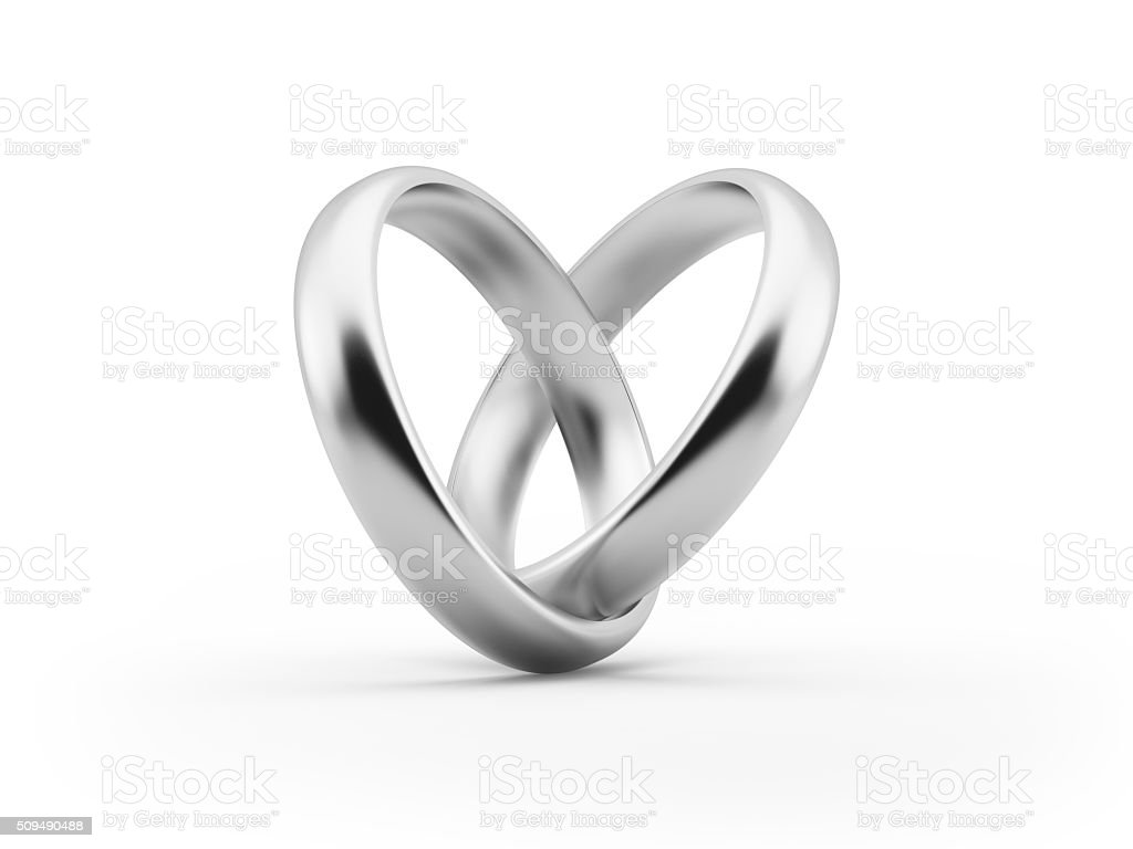 White Gold Wedding Rings Forming A Heart Shape stock photo
