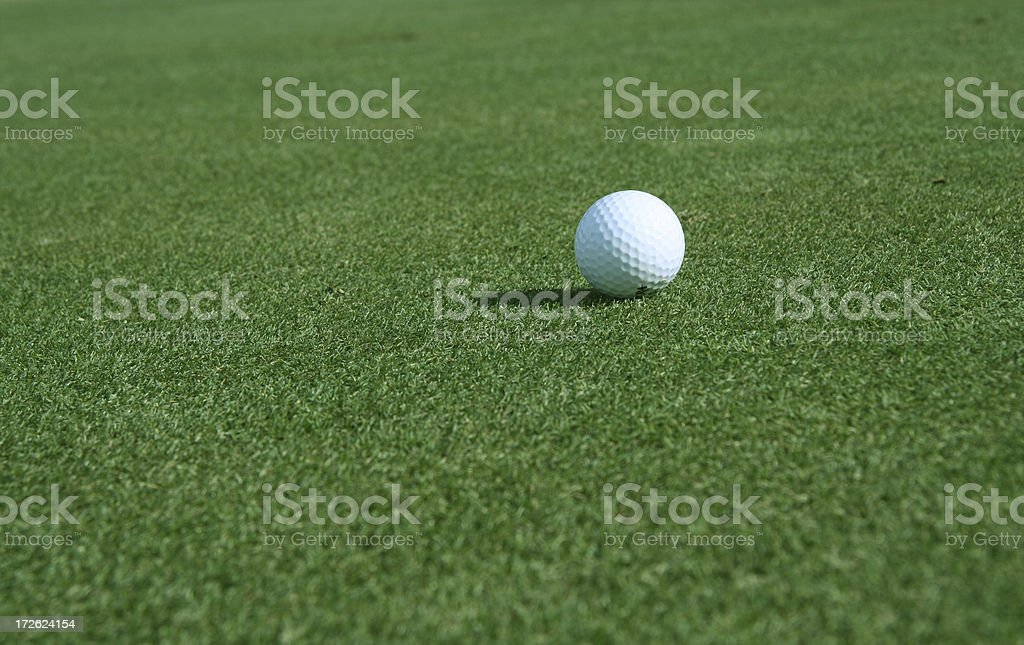 White Golf Ball In Position For A Shot Lined Up royalty-free stock photo
