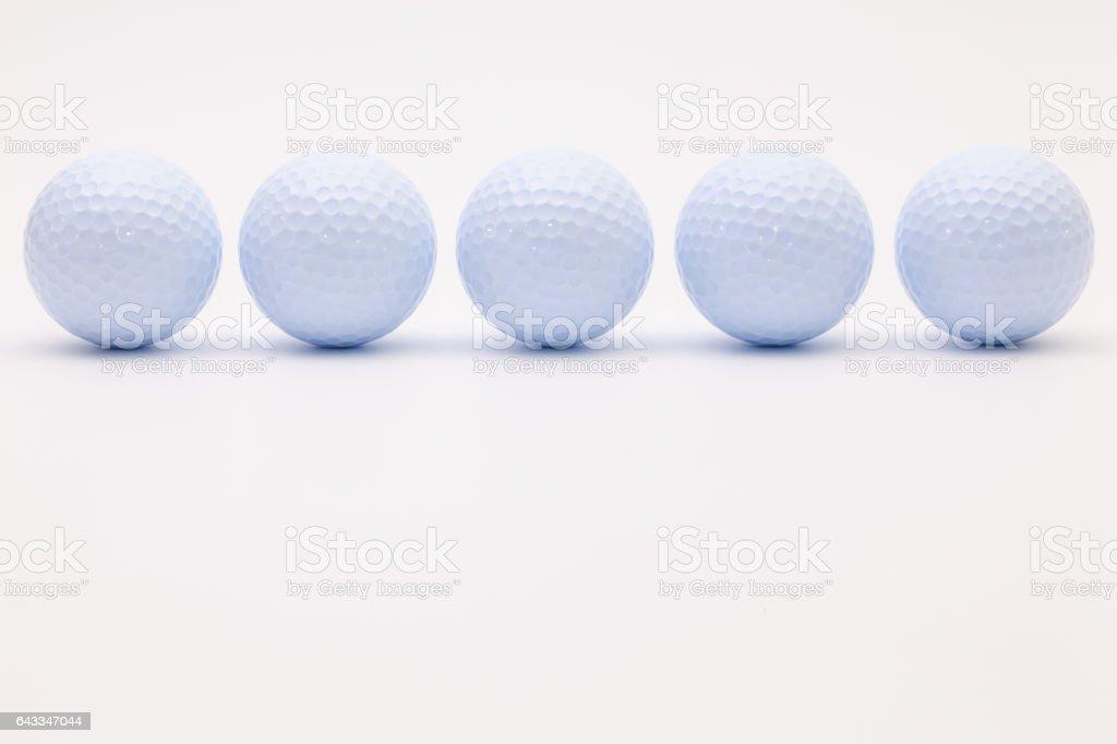 White golf balls stock photo