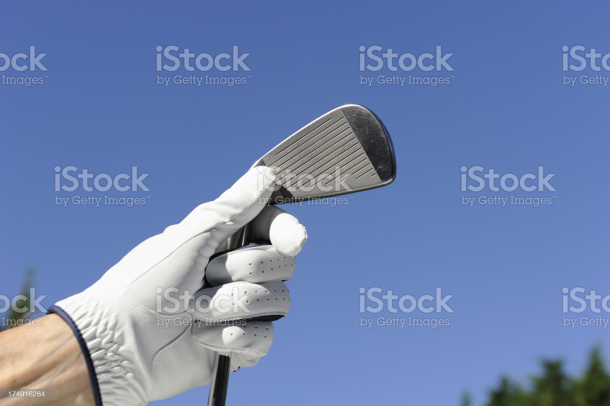 White golf glove and iron club royalty-free stock photo
