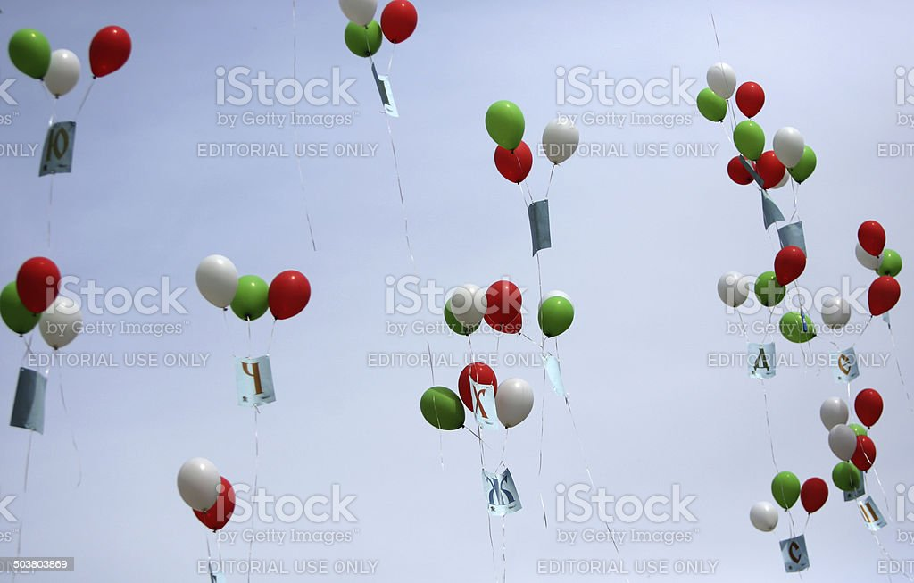 White, green and red balloons stock photo