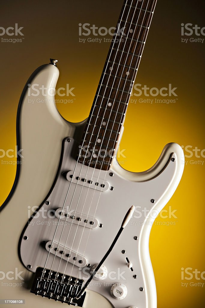 White Guitar Isolated On Yellow Spotlight royalty-free stock photo