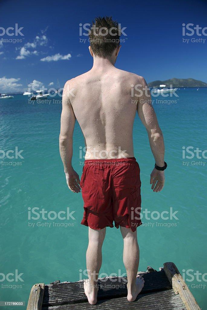 White Guy Red Shorts Blue Sea royalty-free stock photo