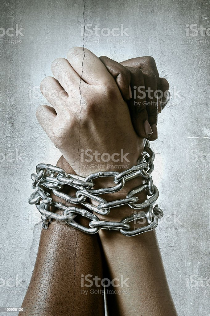 white hand chain locked together with black ethnicity multiracial understanding stock photo
