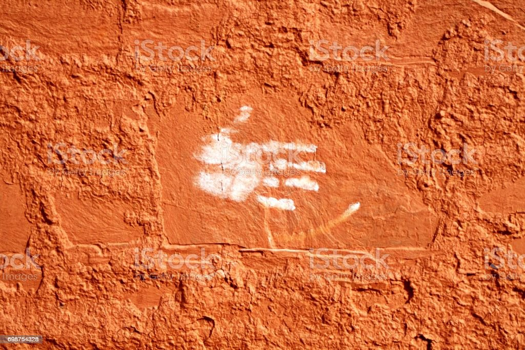 White hand on red wall stock photo