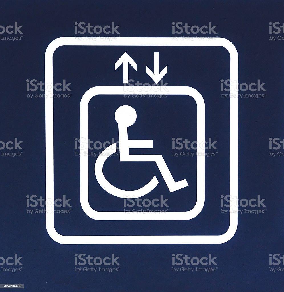 White Handicap Elevator Sign on Blue Background, Closeup stock photo