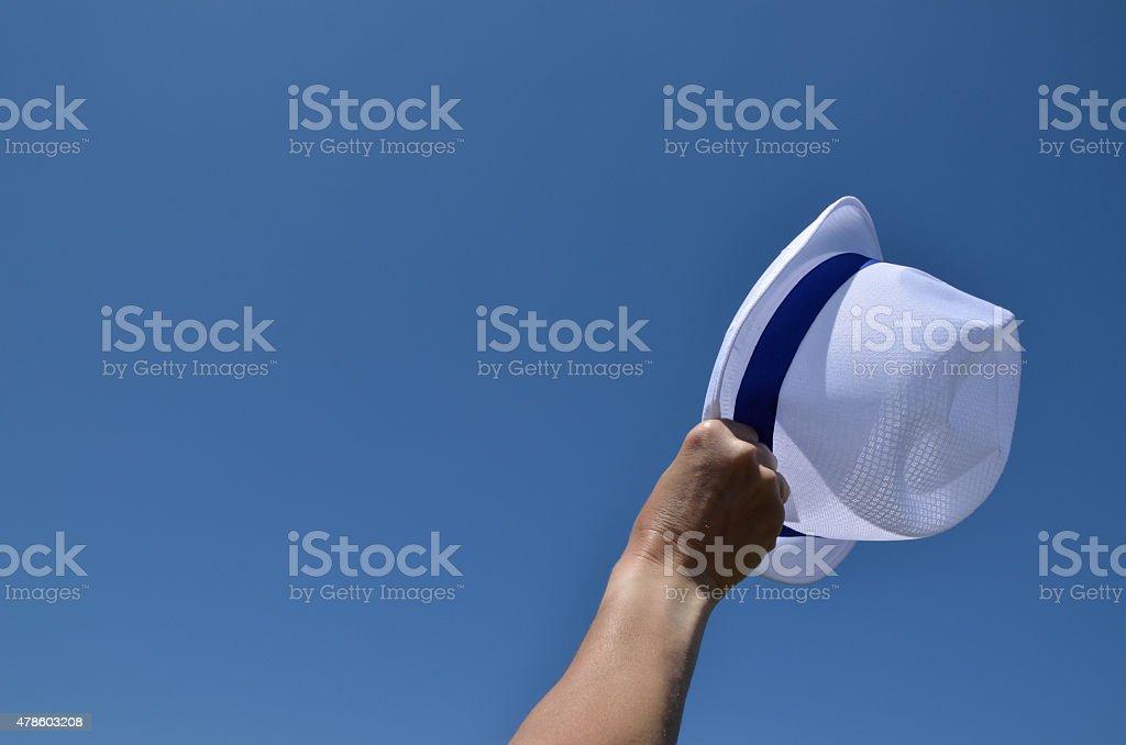 White hat under blue sky stock photo