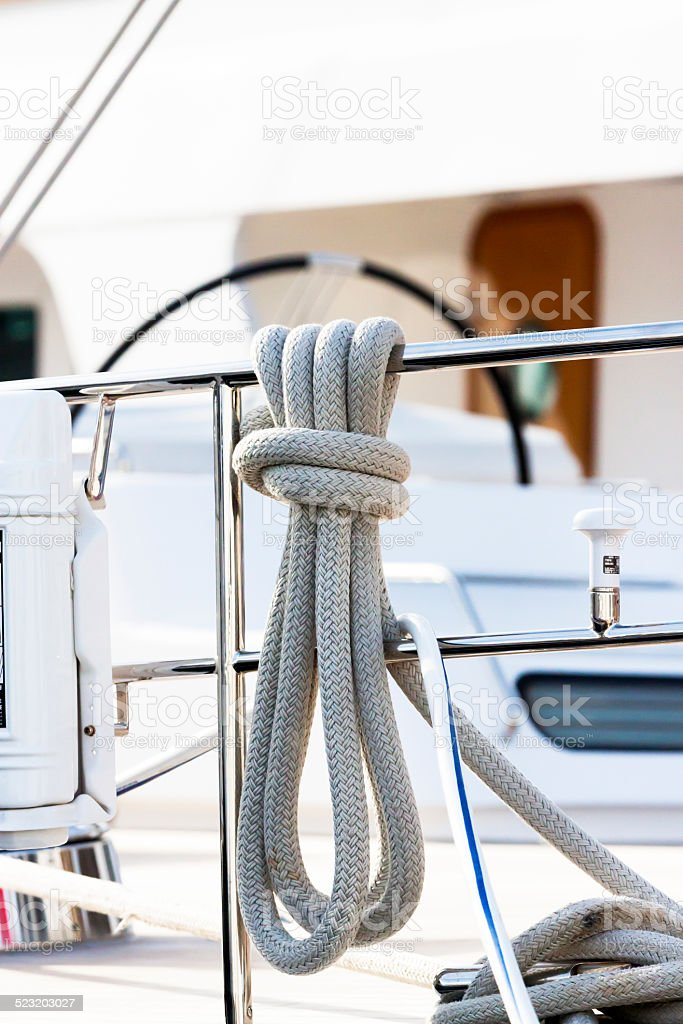 White Hawser-rope hanging on railng of yacht stock photo