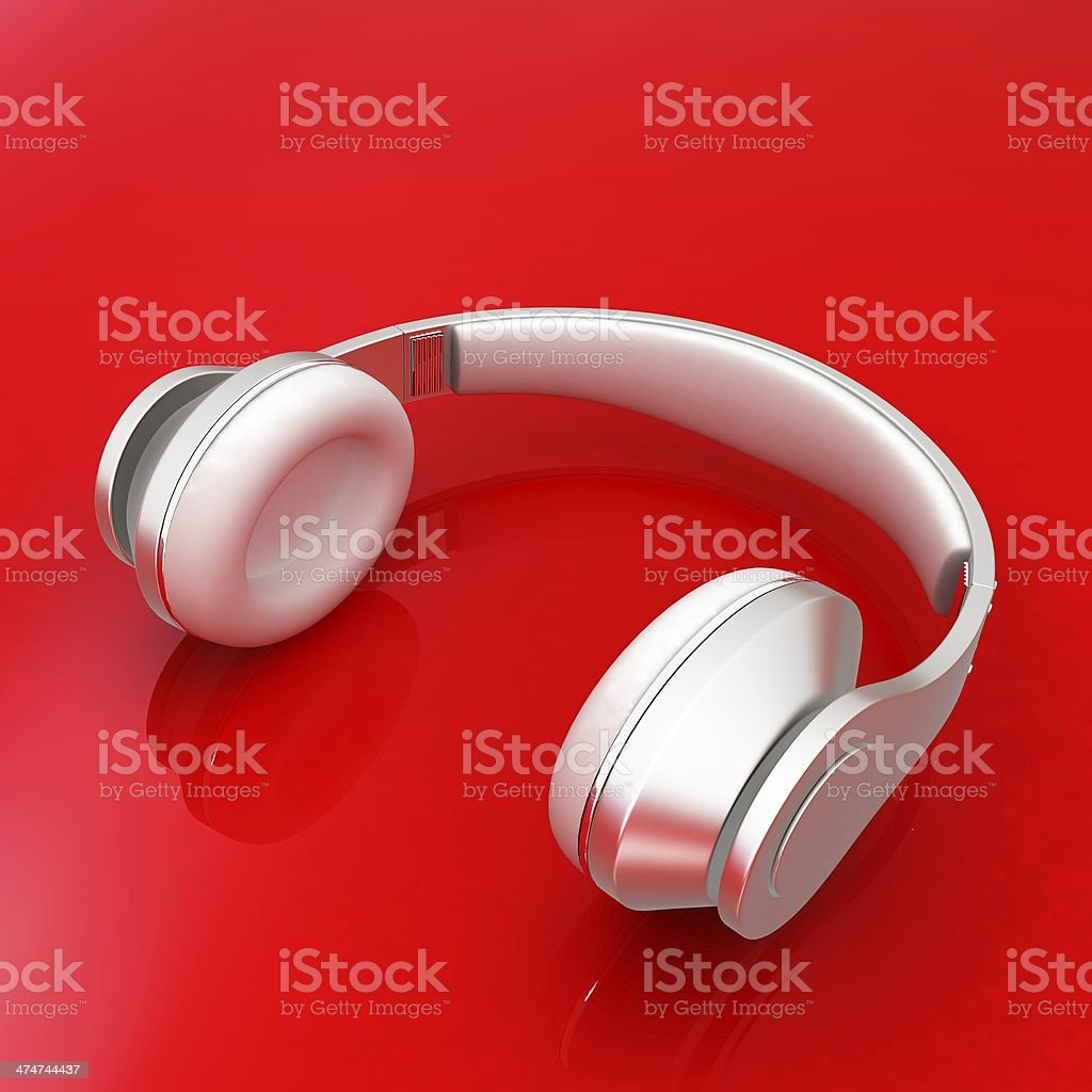 White headphones isolated on a red background stock photo