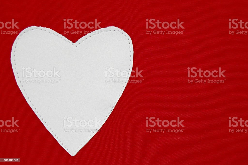 White heart against red background stock photo