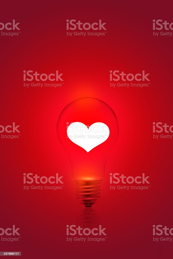 white heart shape on red light bulb background, blank text stock photo