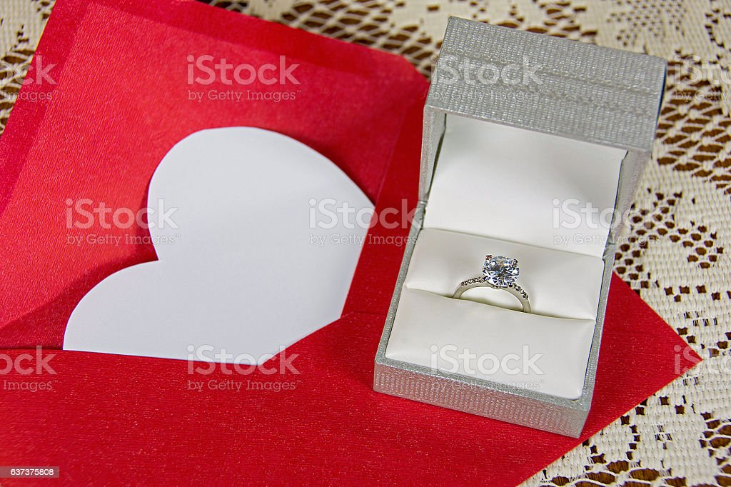 white heart with diamond ring stock photo