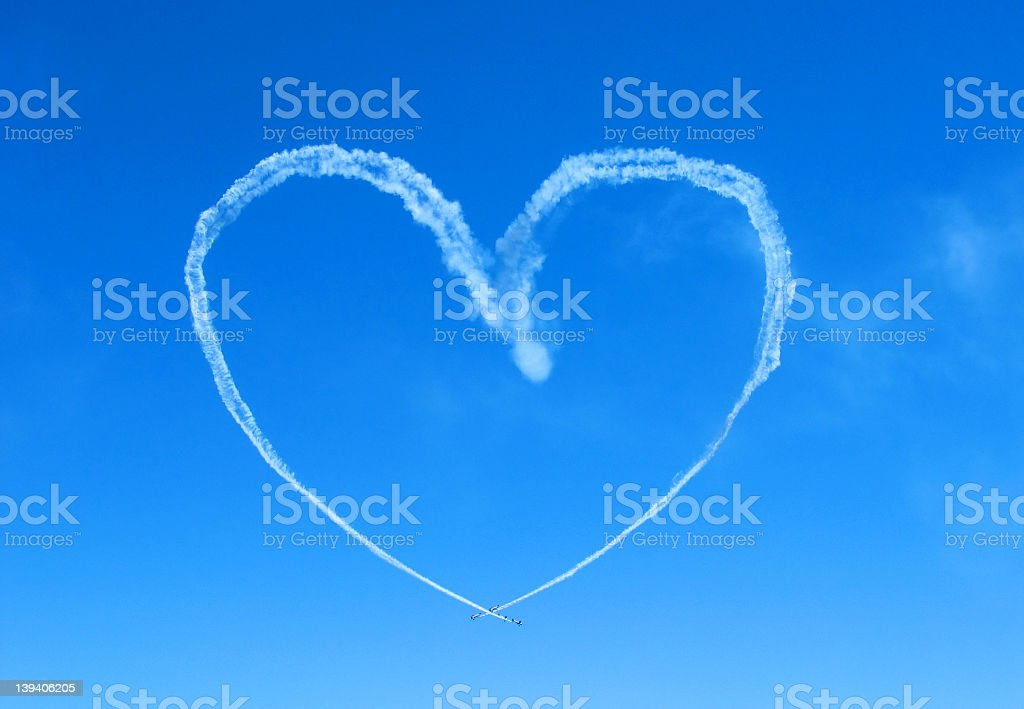 White heart written in the blue sky royalty-free stock photo