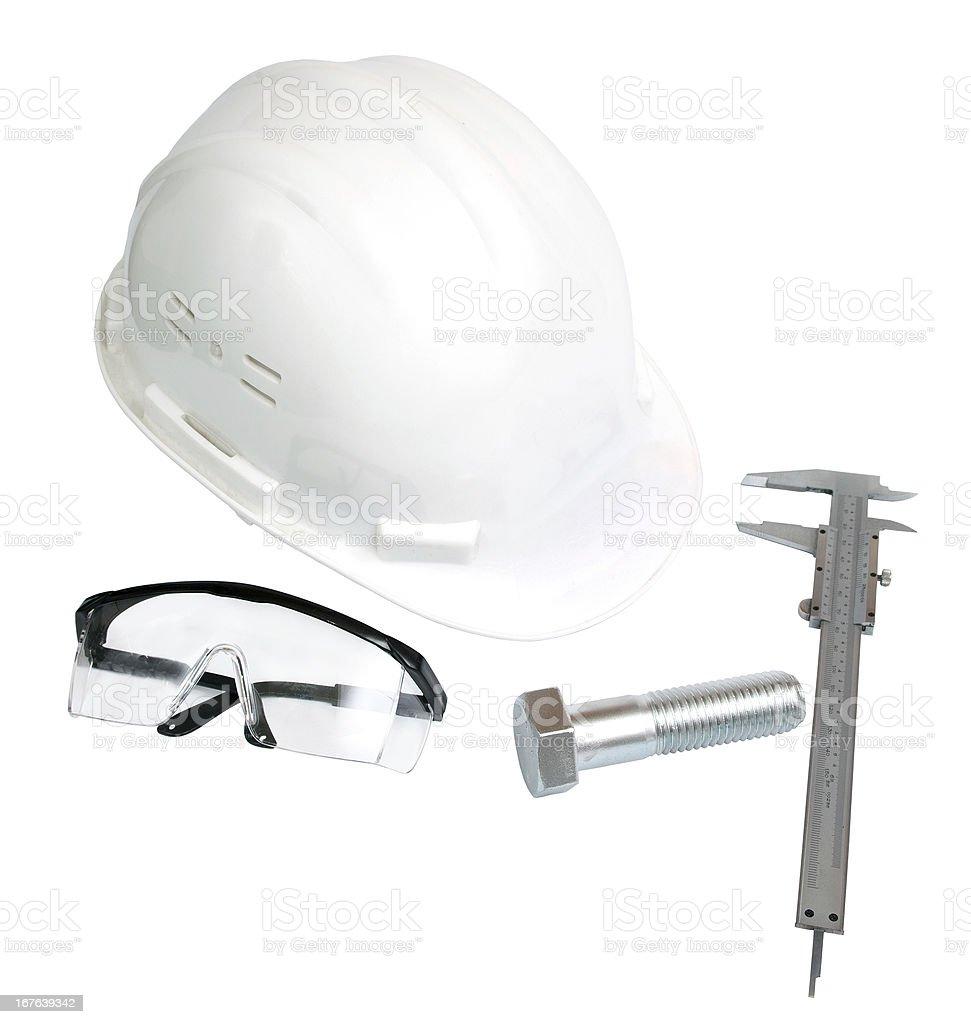 white helmet, vernier caliper, eye-wear and a big bold stock photo
