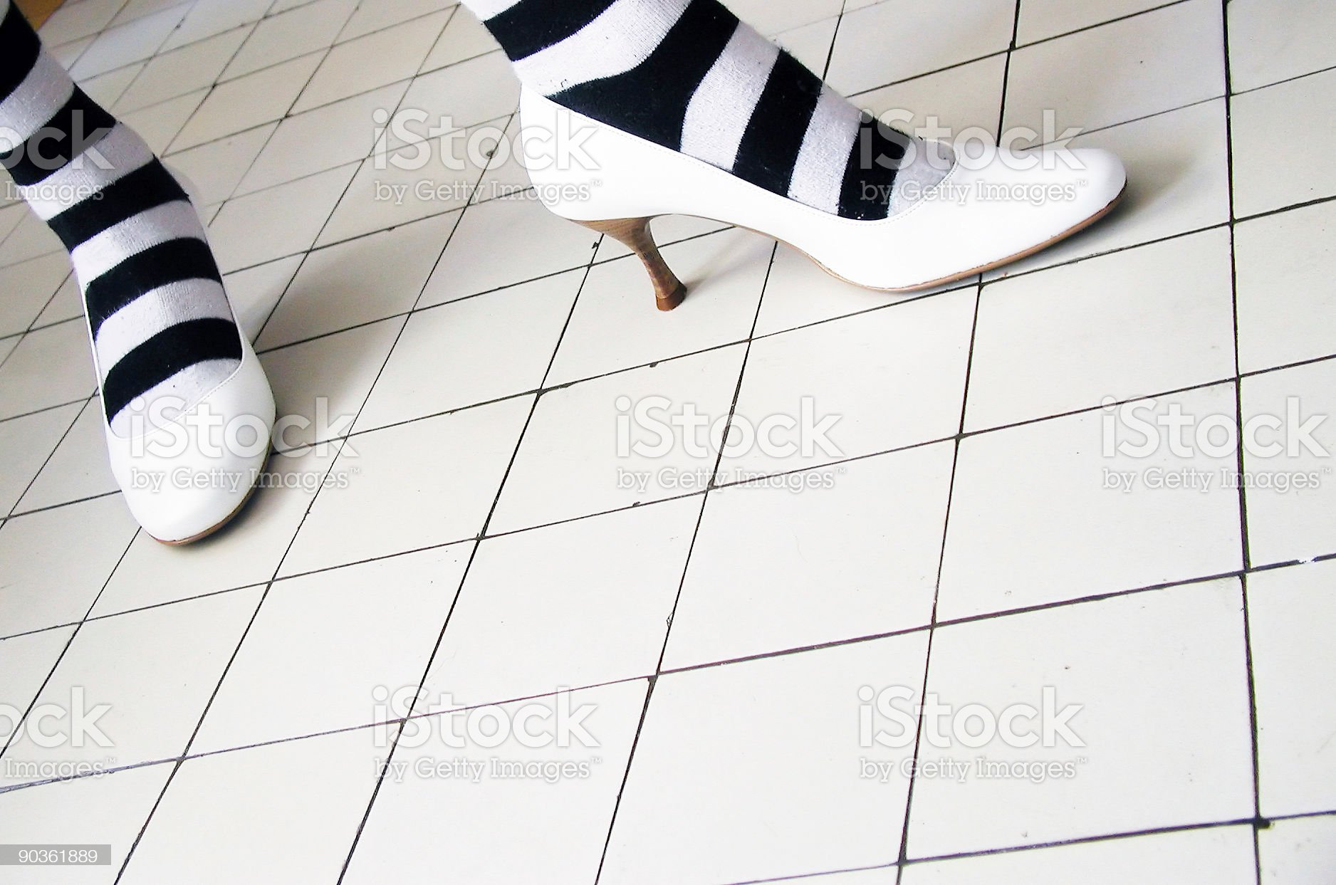 White high heel shoes with unsuitable socks royalty-free stock photo