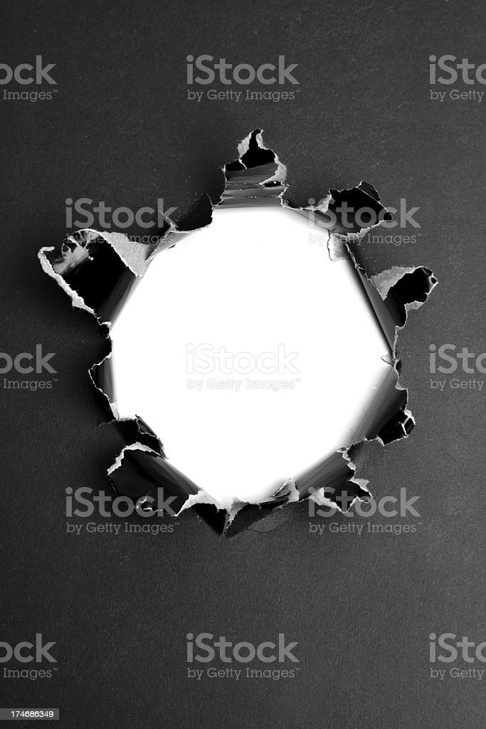 White hole in black paper royalty-free stock photo