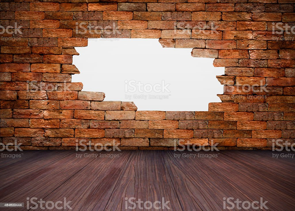 White hole in brick wall and wood floor royalty-free stock photo