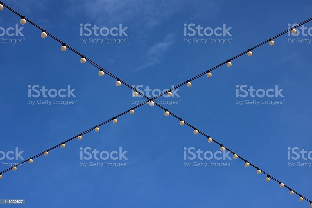 White Holiday Lights against Sky royalty-free stock photo