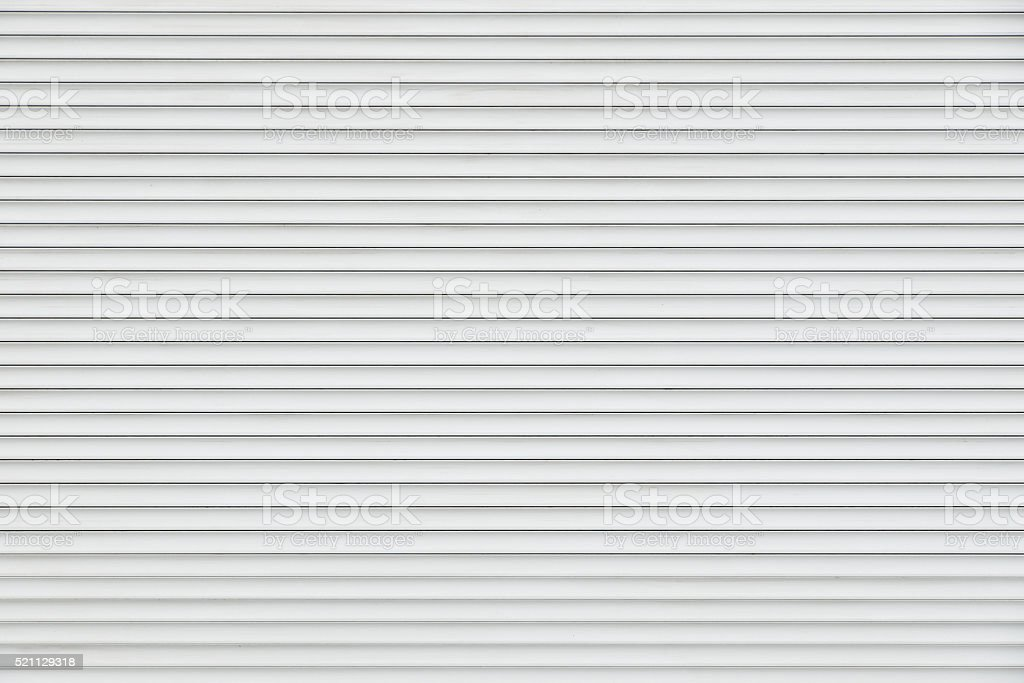 White horizontal metal roller blinds stock photo