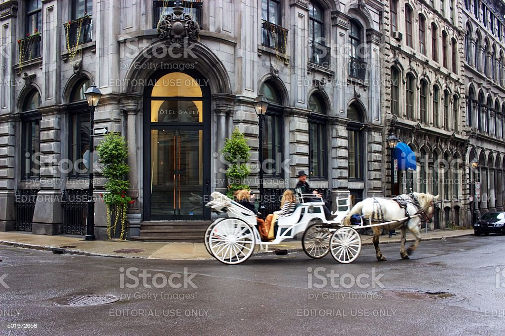 White horse and carriage, historic buildings, Old Montreal, Quebec, Canada stock photo