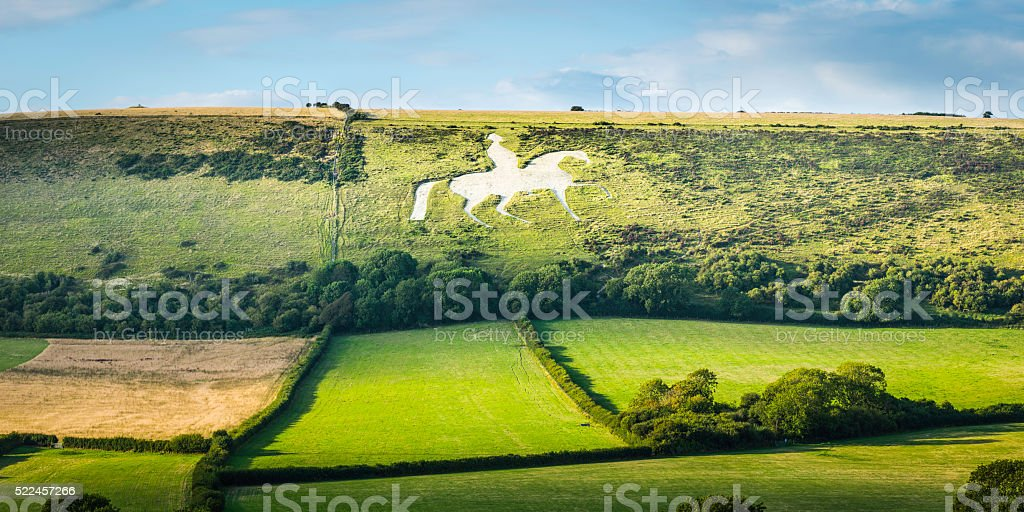 White horse historic chalk figure carved into English countryside panorama stock photo