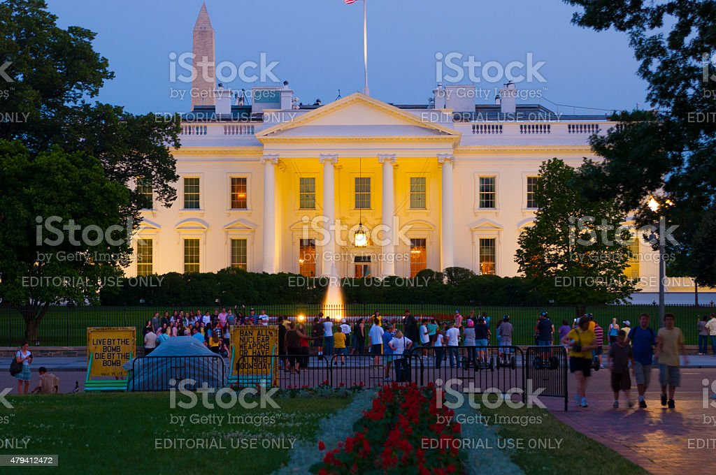 White House at dusk with tourists stock photo