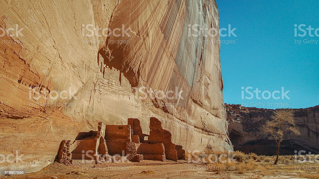 White House ruins near an amazing rock face stock photo