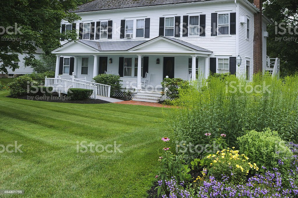 A white house with a big garden and a handicapped entrance  stock photo