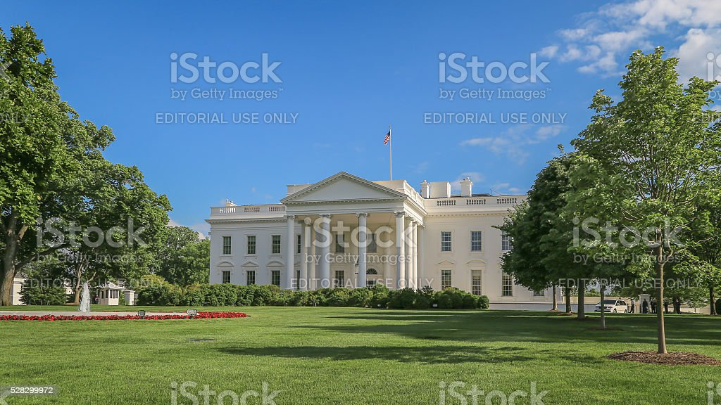 White house with blue sky stock photo