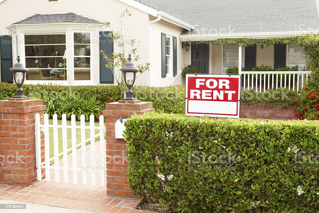 White house with red for rent sign outside stock photo